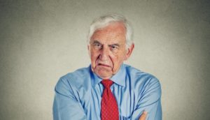 angry white guy wearing blue shirt and red tie