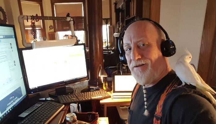 mitch Rezman wearing headset in front of several computers