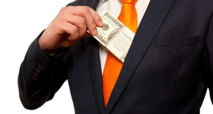 man slippng cash into upper suit coat jacket pocket