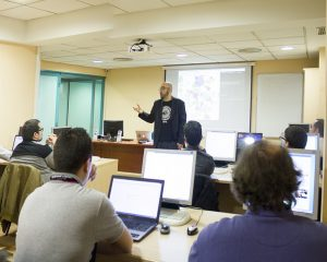 Professor teaching computer class